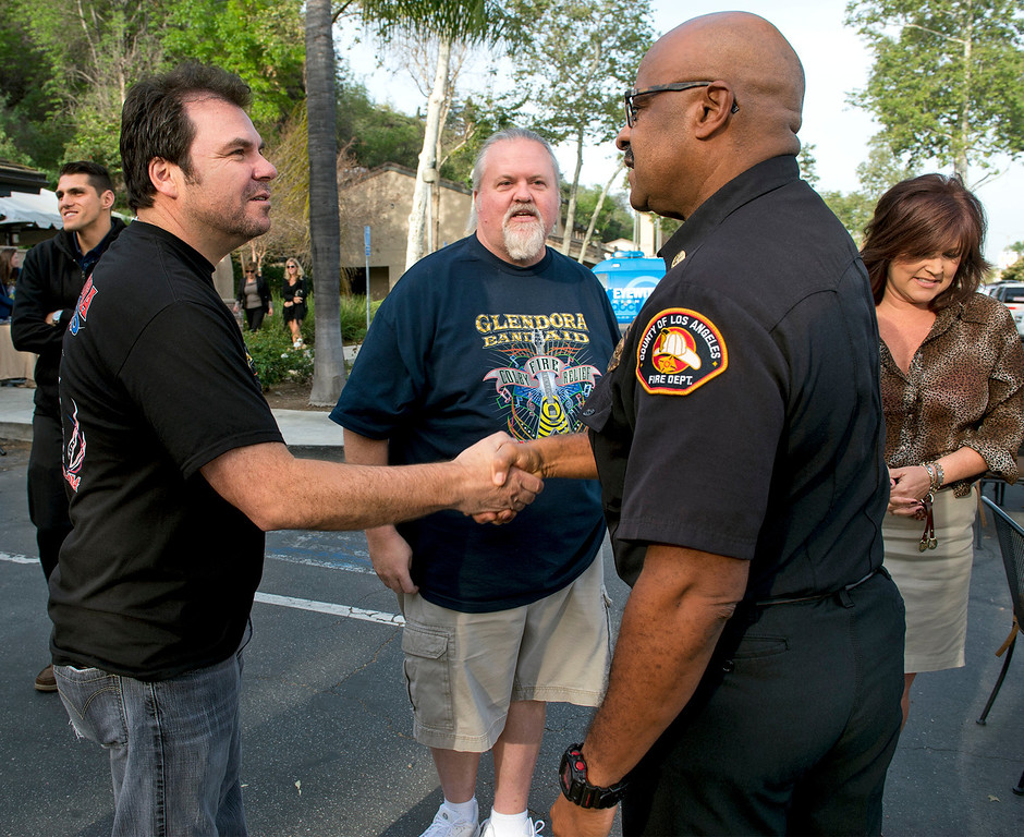 . Foothill Musicians Giving Back Chuck Castellanos, left, and Michael Beatty greet LA County Fire Department battalion chief Arthur Ellis during a pancake breakfast in appreciation to those that fought the Colby Fire in Glendora March 20, 2014.  (Staff photo by Leo Jarzomb/San Gabriel Valley Tribune)