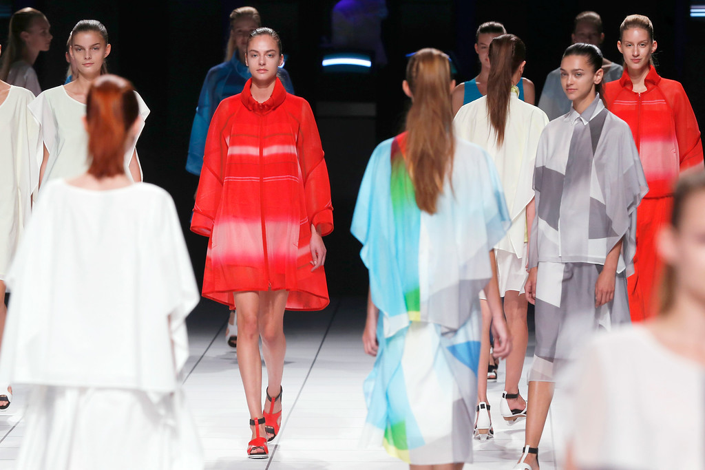 . Models present creations as part of Issey Miyake\'s ready-to-wear Spring/Summer 2014 fashion collection, presented Friday, Sept. 27, 2013 in Paris. (AP Photo/Jacques Brinon)