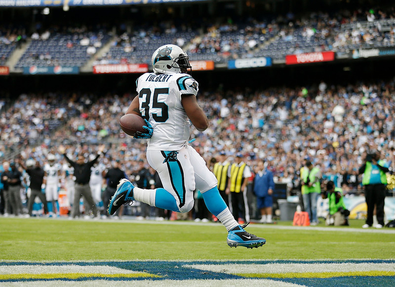 . Carolina Panthers fullback Mike Tolbert sails into the end zone untouched while scoring his second touchdown against the San Diego Chargers during the first half of a NFL football game Sunday, Dec. 16, 2012, in San Diego. (AP Photo/Gregory Bull)