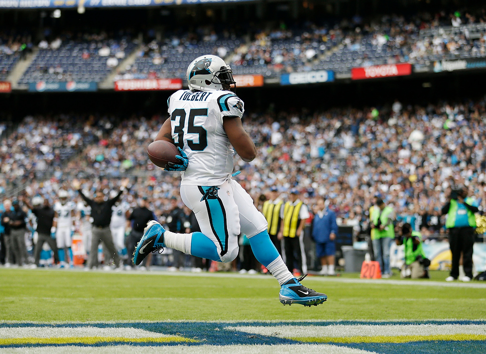 Description of . Carolina Panthers fullback Mike Tolbert sails into the end zone untouched while scoring his second touchdown against the San Diego Chargers during the first half of a NFL football game Sunday, Dec. 16, 2012, in San Diego. (AP Photo/Gregory Bull)