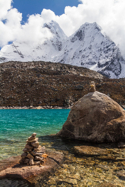View of stack of rocks and boulder in front Ama Dablam mountain and Gokyo Lake - Nepal