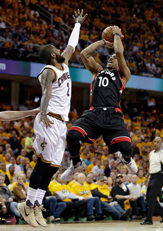 . Toronto Raptors\' DeMar DeRozan (10) shoots over Cleveland Cavaliers\' Kyrie Irving (2) in the first half in Game 1 of a second-round NBA basketball playoff series Monday, May 1, 2017, in Cleveland. (AP Photo/Tony Dejak)