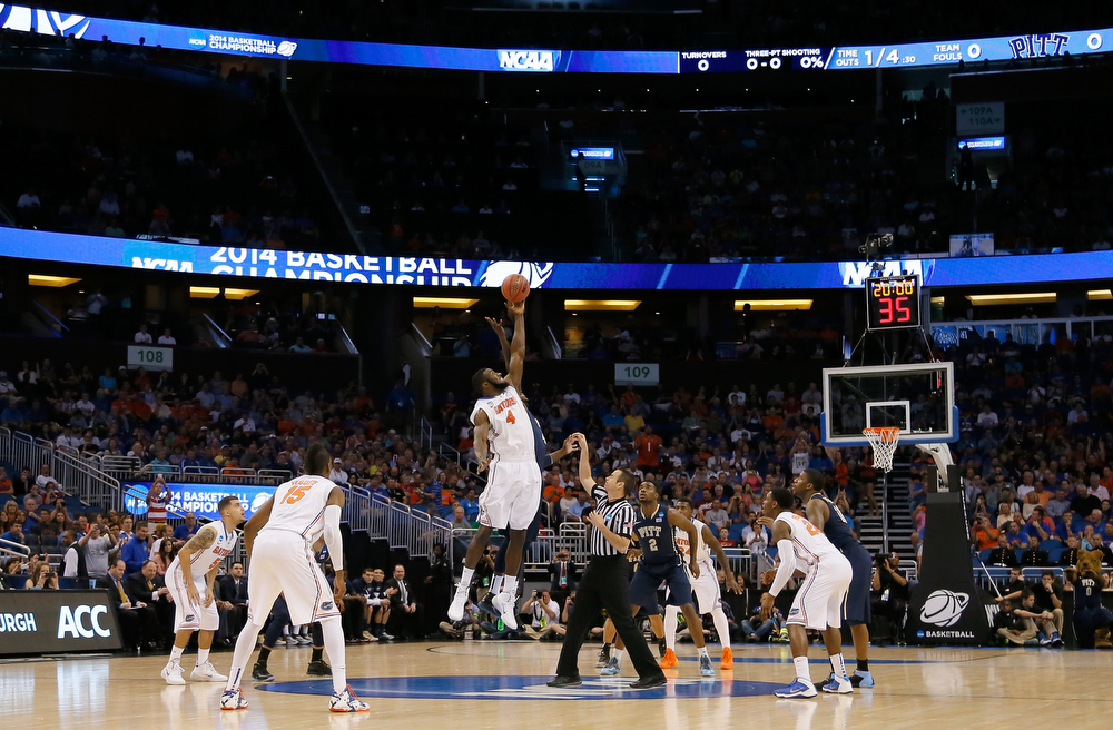 . Patric Young #4 of the Florida Gators and Talib Zanna #42 of the Pittsburgh Panthers go after the opening jump to start the third round of the 2014 NCAA Men\'s Basketball Tournament at Amway Center on March 22, 2014 in Orlando, Florida.  (Photo by Kevin C. Cox/Getty Images)