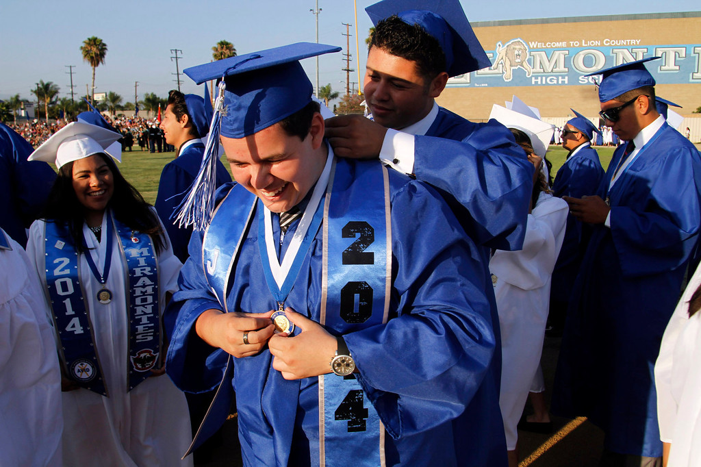 . El Monte High School graduates get ready for the El Monte High School Class of 2014 Commencement Ceremony, at El Monte High School\'s Football Stadium in El Monte, CA., Wednesday, June 11, 2014.  (Photo by James Carbone for the San Gabriel Valley Tribune)