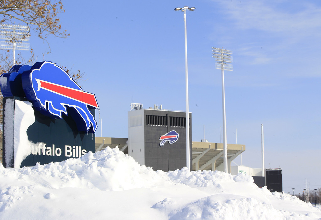 . Snow covers  a sign at Ralph Wilson Stadium,  home of the Buffalo Bills in Orchard Park, N.Y. on Wednesday, Nov. 19, 2014.  A ferocious lake-effect storm left the Buffalo area buried under 6 feet of snow Wednesday, trapping people on highways and in homes, and another storm expected to drop 2 to 3 feet more was on its way. (AP Photo/The Buffalo News, Harry Scull Jr.)