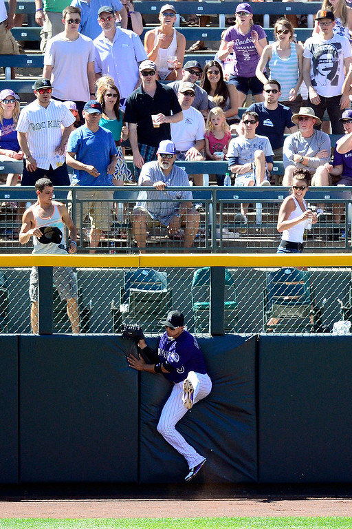 . Colorado Rockies left fielder Carlos Gonzalez (5) makes an bases-loaded, inning-ending catch on a ball hit by San Diego Padres right fielder Will Venable (25) during the action in Denver. The Colorado Rockies hosted the San Diego Padres at Coors Field on Sunday, June 9, 2013. (Photo by AAron Ontiveroz/The Denver Post)