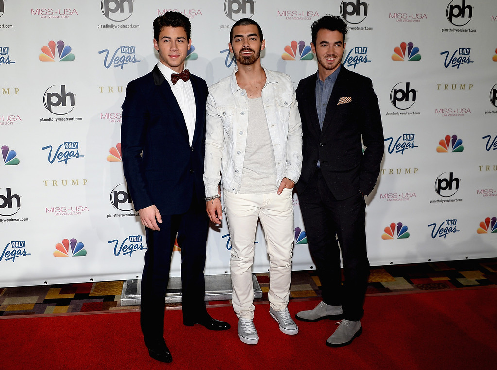 . (L-R) Recording artists Nick Jonas, Joe Jonas and Kevin Jonas (whatever order) of the Jonas Brothers arrive at the 2013 Miss USA pageant at Planet Hollywood Resort & Casino on June 16, 2013 in Las Vegas, Nevada.  (Photo by Ethan Miller/Getty Images)