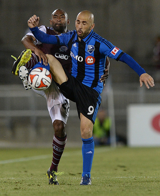 . Colorado defender Marvell Wynne (22) competed for the ball with Montreal forward Marco Di Vaio (9) in the second half. The Colorado Rapids defeated the Montreal Impact 4-1 Saturday night, May 24, 2014. (Photo by Karl Gehring/The Denver Post)