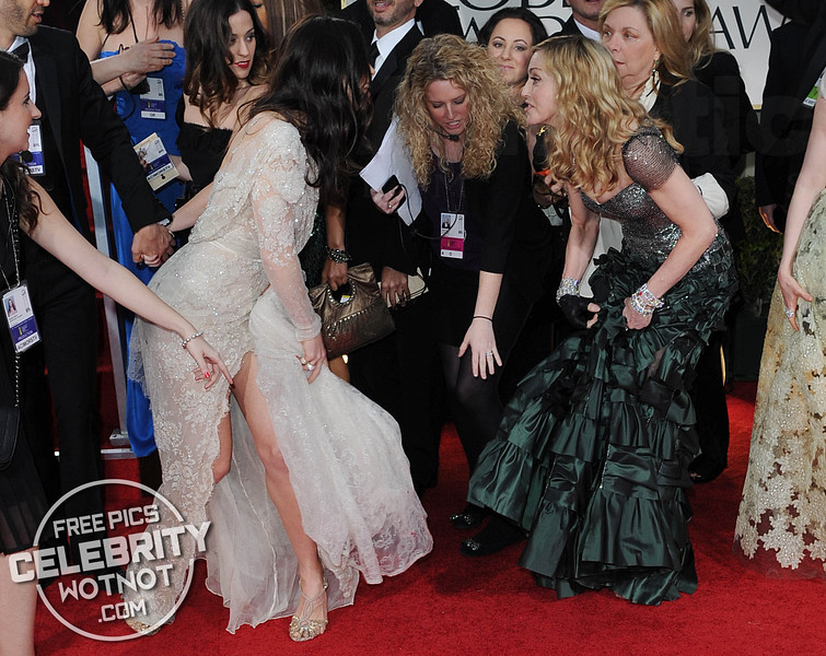 Madonna Steps on Jessica Biel's Dress At The Golden Globes!