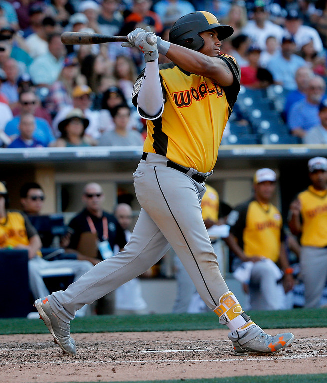 . World Team\'s Josh Naylor, of the Miami Marlins, hits against the U.S. Team during the sixth inning of the All-Star Futures baseball game, Sunday, July 10, 2016, in San Diego. (AP Photo/Lenny Ignelzi)