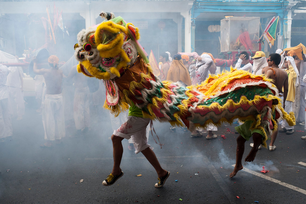 . Vegetarian festival devotees of Jui Tui shrine parade through the streets dressed up as a dragon as firecrackers go off  on September 30, 2014 in Phuket, Thailand.  (Photo by Borja Sanchez-Trillo/Getty Images)