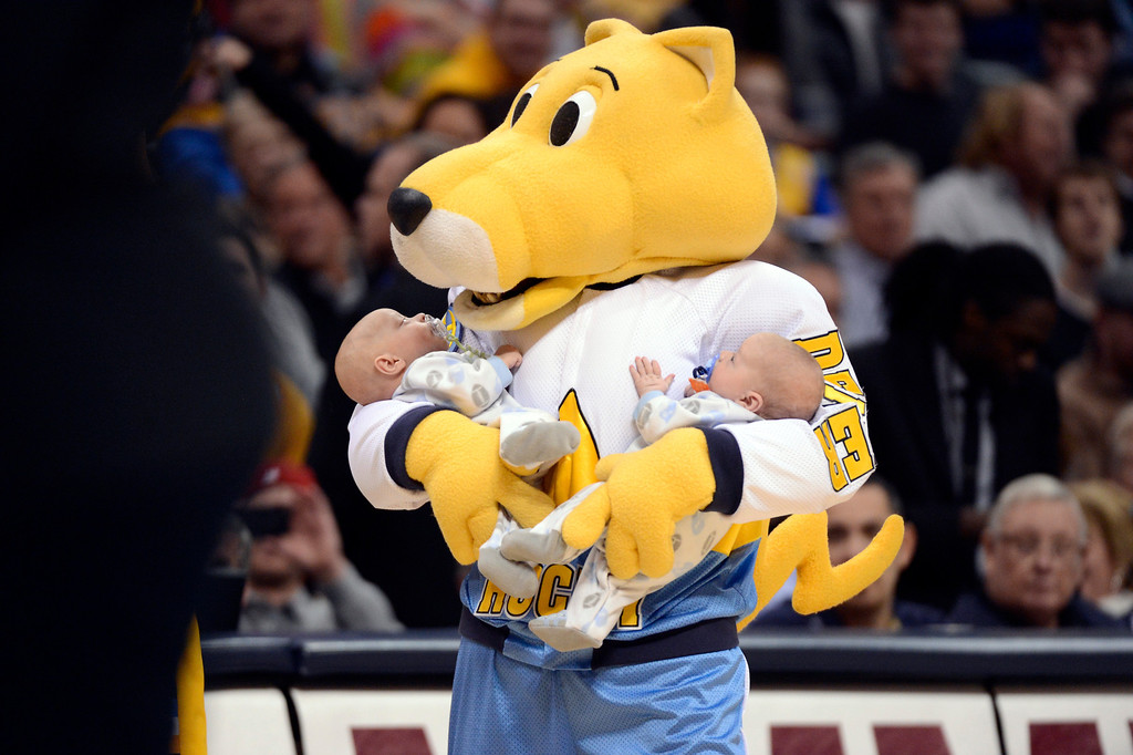 . Denver Nuggets mascot Rocky takes a cruise around the court with twin boys Aidan an dWill Loftus 3mos old of Denver during the Denver Nuggets  Portland Trail Blazers game Tuesday, January 15, 2013 at Pepsi Center. John Leyba, The Denver Post