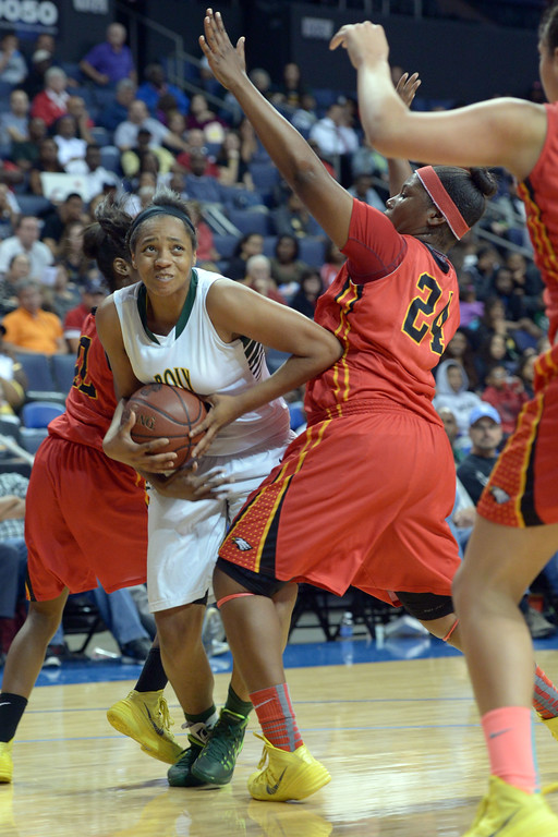 . Poly\'s Jada Matthews is fouled by Etiwanda\'s Amy Okonkwo, right, at Citizens Business Bank Arena in Ontario, CA on Saturday, March 22, 2014. Long Beach Poly vs Etiwanda in the CIF girls open division regional final. 1st half, Photo by Scott Varley, Daily Breeze)