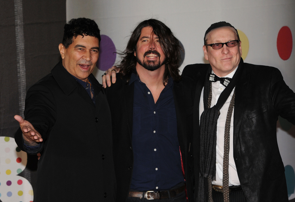 Description of . Pat Smear, Dave Grohl and  Rick Nielsen of the Sound City Players attend the Brit Awards 2013 at the 02 Arena on February 20, 2013 in London, England.  (Photo by Eamonn McCormack/Getty Images)