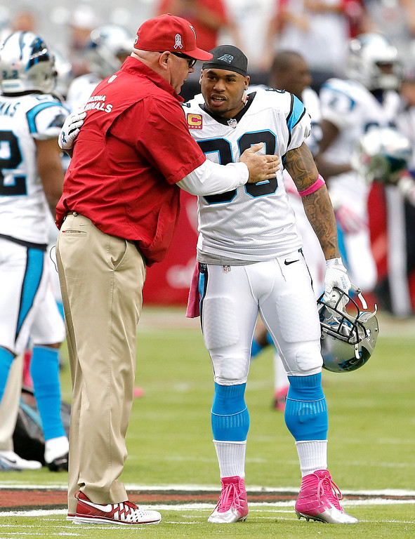 . Arizona Cardinals head coach Bruce Arians, left, greets Carolina Panthers wide receiver Steve Smith (89) prior to a NFL football game, Sunday, Oct. 6, 2013, in Glendale, Ariz. (AP Photo/Matt York)