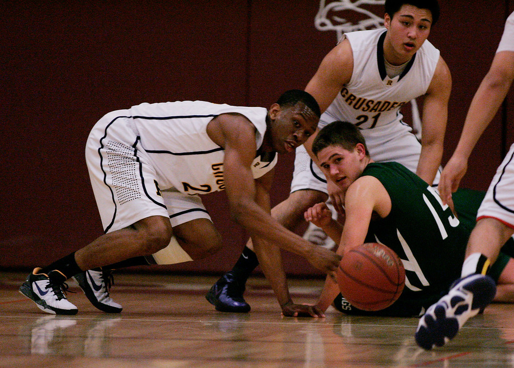 . Paly\'s Mathias Schmutz watches as Riordin\'s Chiefy Ugbaja goes after a loose ball in the second quarter at Piedmont Hills High School in San Jose, Calif. on Friday, Feb. 22, 2013.The Archbishop Riordan Crusaders played the Palo Alto Vikings in the CCS Open Division boys basketball quarterfinals. (Jim Gensheimer/Staff)