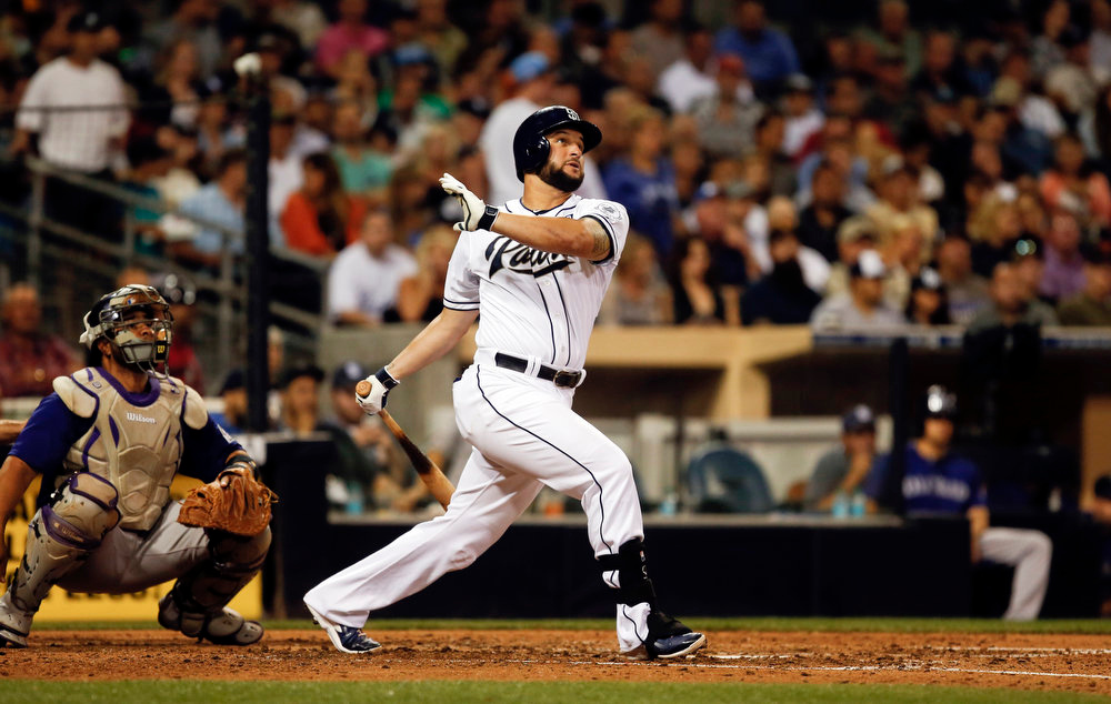 . San Diego Padres\' Yonder Alonso and Colorado Rockies catcher Wilin Rosario watch Alonso\'s solo home run in the fourth inning of a baseball game Monday, Aug. 11, 2014, in San Diego. (AP Photo/Lenny Ignelzi)