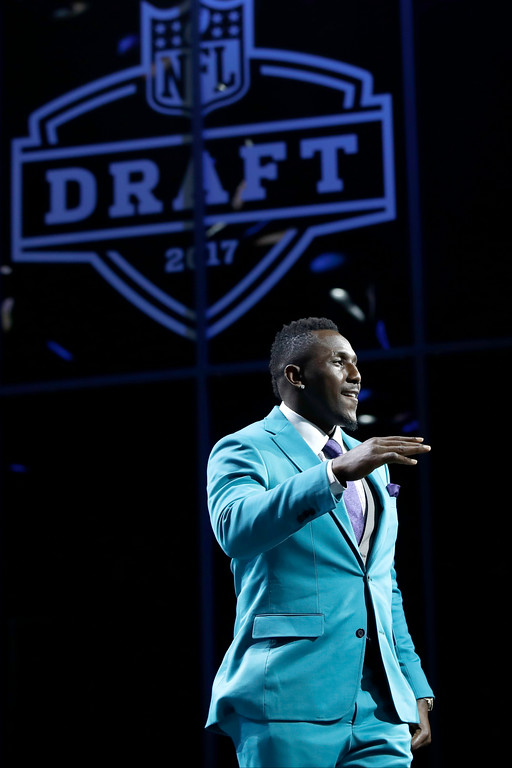 . Carolina Panthers\' Thomas Davis waves as he arrives to announce the Panthers selection during the first round of the 2017 NFL football draft, Thursday, April 27, 2017, in Philadelphia. (AP Photo/Matt Rourke)