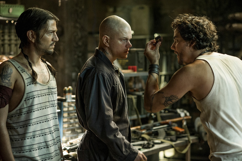 . Max (MATT DAMON, center), Julio (DIEGO LUNA, left) and Spider (WAGNER MOURA) meet inside Spider\'s armory in Columbia Pictures\' ELYSIUM. © 2012 Columbia TriStar Marketing Group, Inc.