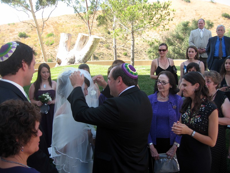 Gary (father of the bride) lowers Abby's veil