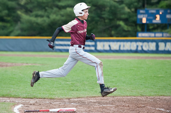 05/14/19 Wesley Bunnell | Staff Newington baseball defeated New Britain 4-3 in a walk off on Tuesday afternoon at Newington High School. Ryan Lipinski (7) scores a run for New Britain.