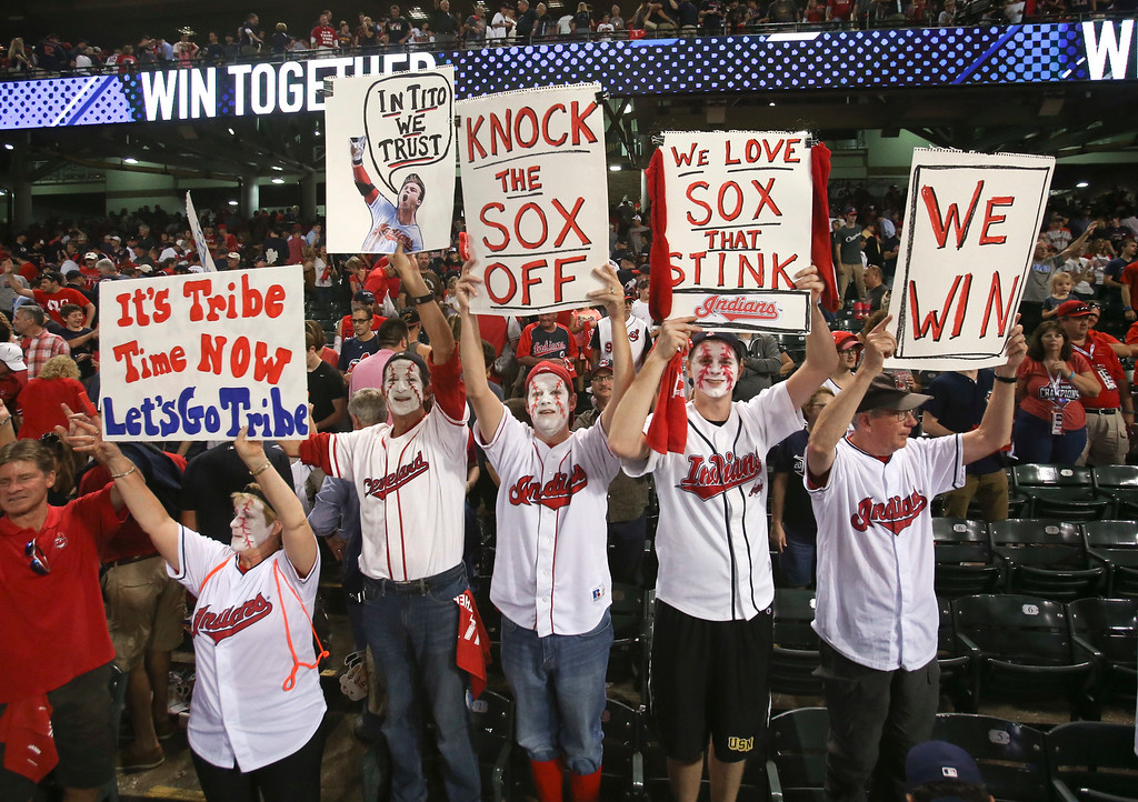 . Cleveland Indians fans celebrate after the Indians defeated the Boston Red Sox 6-0 in Game 2 of a baseball American League Division Series, Friday, Oct. 7, 2016, in Cleveland. (AP Photo/Aaron Josefczyk)