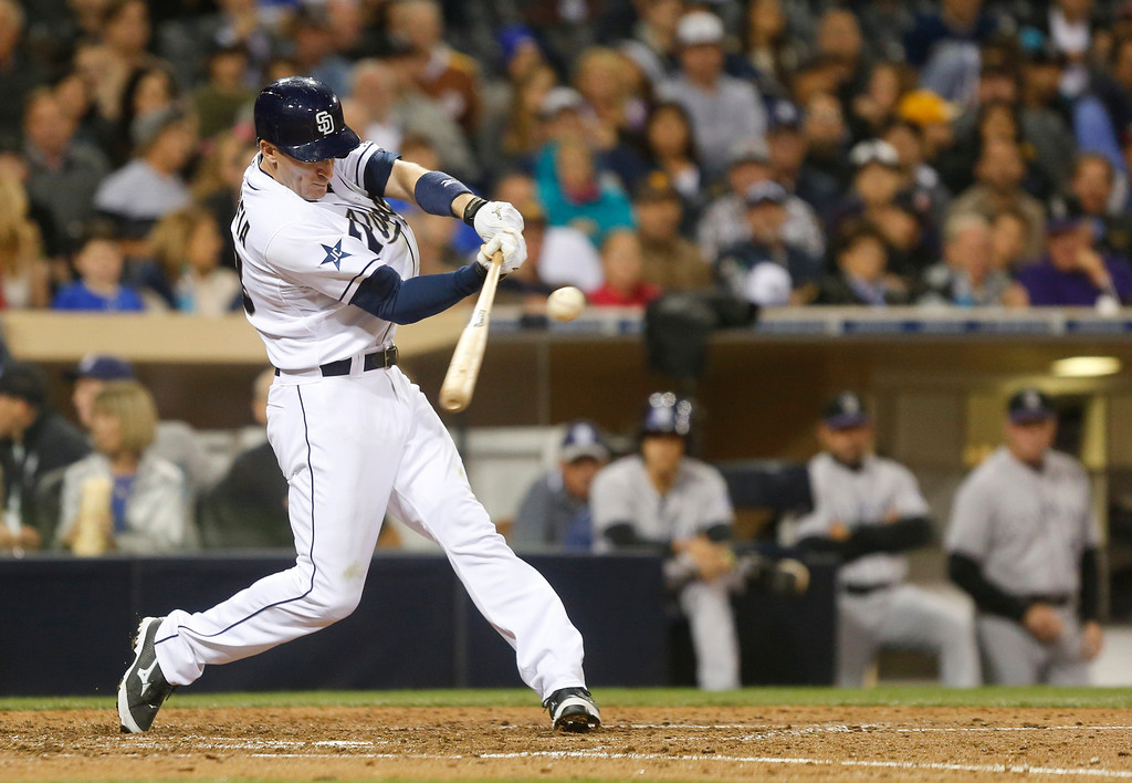 . San Diego Padres\' Chris Denorfia rips a double down the right field line that drives in a run against the Colorado Rockies in the fifth inning of a baseball game Wednesday, April 16, 2014, in San Diego.  (AP Photo/Lenny Ignelzi)
