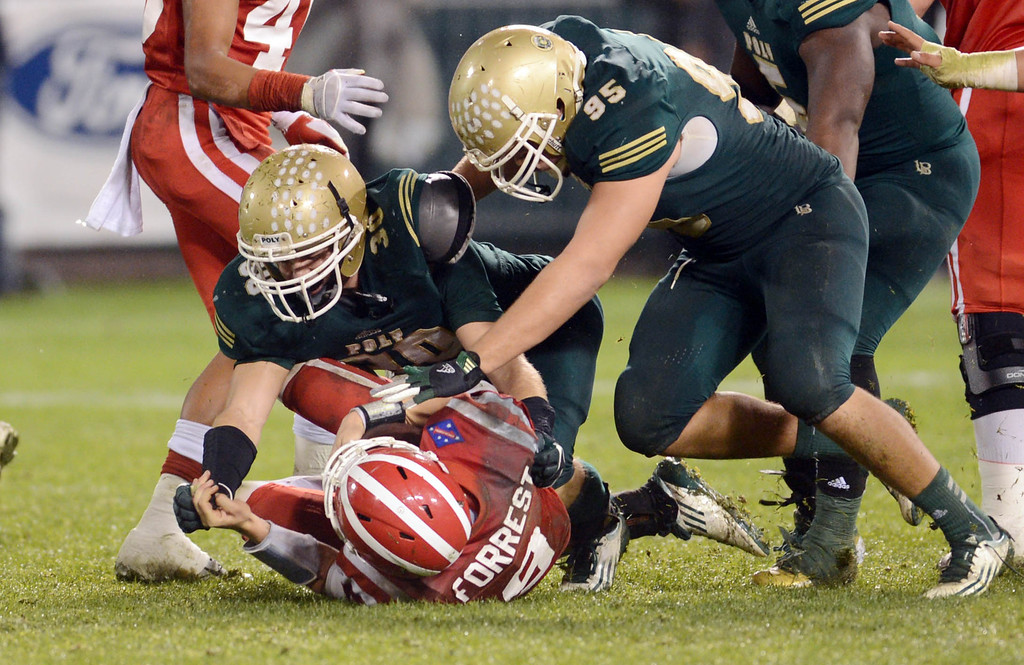 . Anaheim, Calif., --12-01-12 - Long Beach Poly\'s Roman Wiant,30,  sack Mater Dei\'s quarterack Chase Forrest ,9, in the 4th quarter of the CIF-SS Pac-5 Division final game, at Anaheim Stadium.   Stephen Carr/  LANG