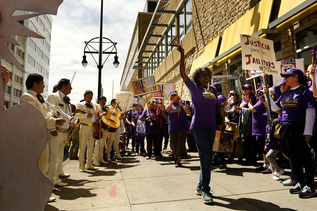 . Denver, CO - ARRIL 14: Mariachi Musicians march and play with the low wage janitors at 16th St and Cleveland Pl as they stop to demonstrate during the kick off of their contract campaign in downtown with a march past all the buildings where they do their work in Denver. The janitors were joined by local care workers, Fast food, delivery persons and service workers during their  Underpaid Fight for $15 march. April 14, 2016 in Denver, CO. (Photo By Joe Amon/The Denver Post)