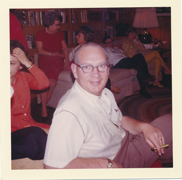 Royie in the back seating on couch arm