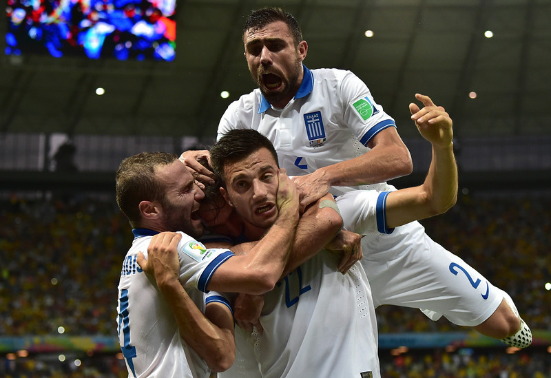 . Greece\'s midfielder Andreas Samaris (C) celebrates with teammates after scoring a goal during the Group C football match between Greece and Ivory Coast at the Castelao Stadium in Fortaleza during the 2014 FIFA World Cup on June 24, 2014.  (GABRIEL BOUYS/AFP/Getty Images)