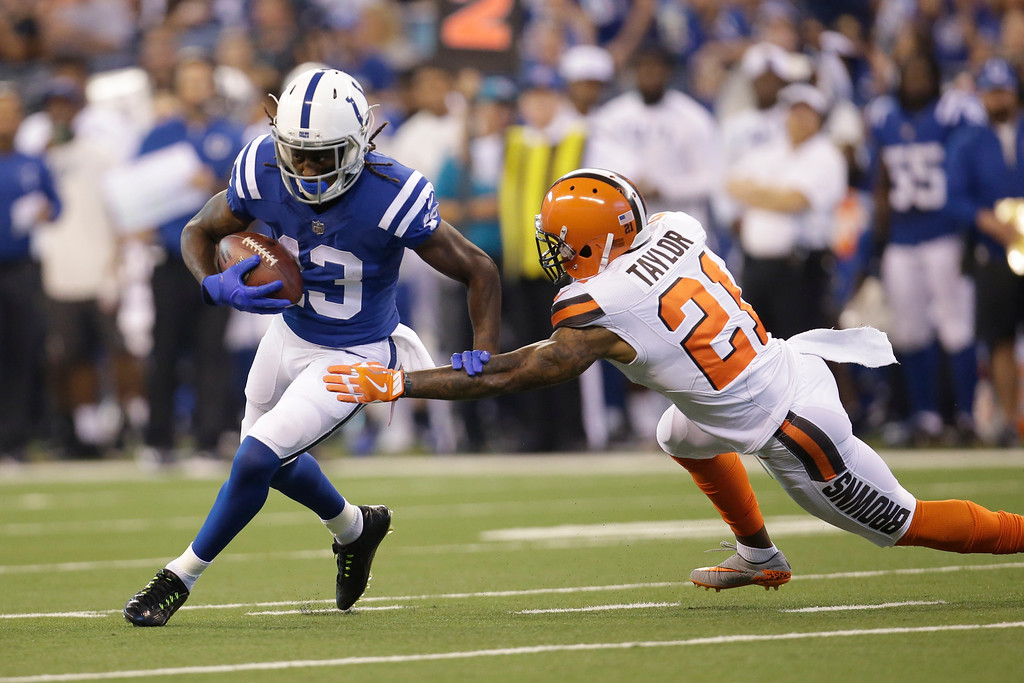 . Indianapolis Colts wide receiver T.Y. Hilton (13) gets around Cleveland Browns cornerback Jamar Taylor (21) after a catch during the first half of an NFL football game in Indianapolis, Sunday, Sept. 24, 2017. (AP Photo/AJ Mast)
