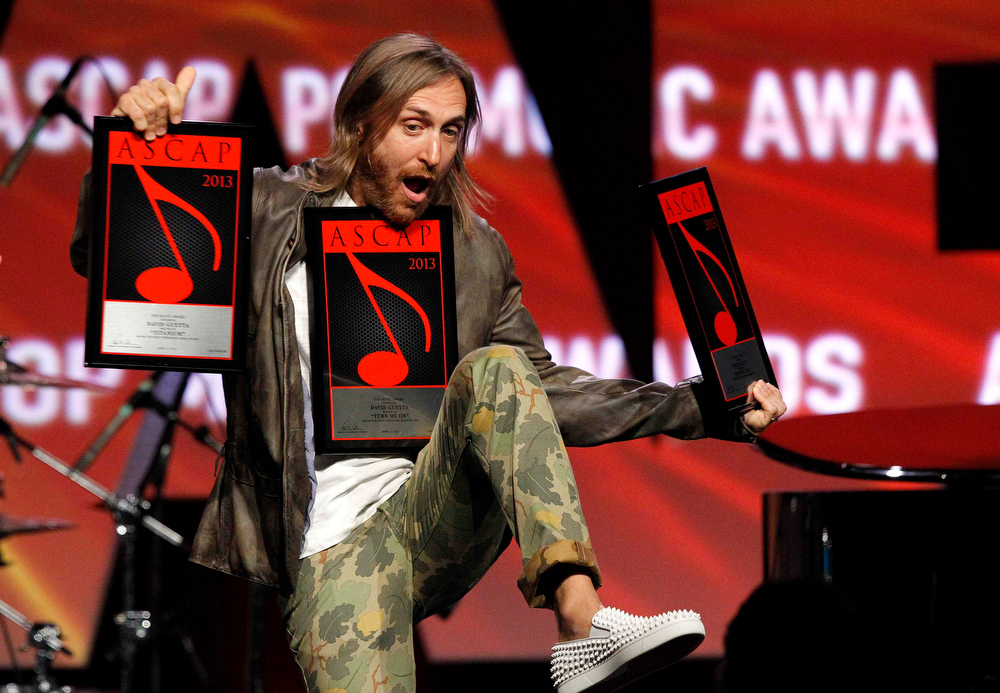 ". DJ David Guetta holds his awards for ""Titanium\"", \""Turn Me On\"" and \""Without You\"" at the 30th annual ASCAP Pop Music Awards in Hollywood, California April 17, 2013.  REUTERS/Mario Anzuoni"