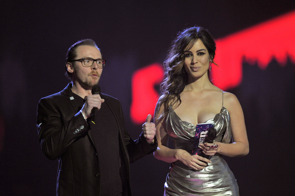 . Simon Pegg and Berenice Marlohe present British Group on stage during the Brit Awards 2013 at the 02 Arena on February 20, 2013 in London, England.  (Photo by Matt Kent/Getty Images)