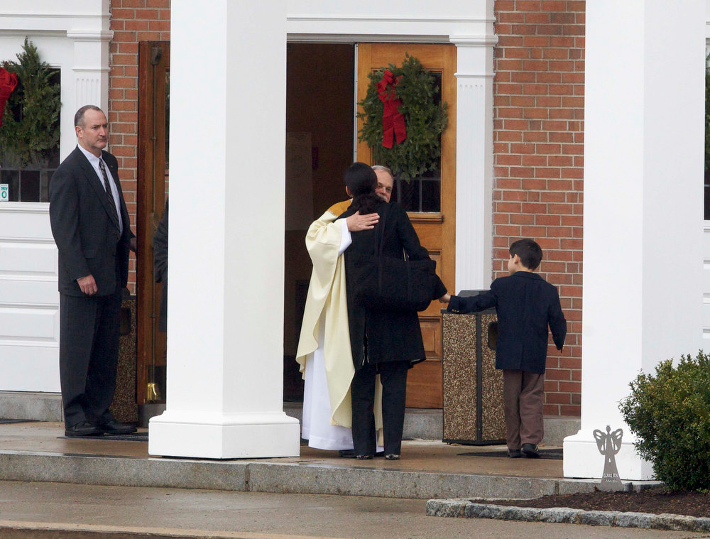 Description of . Mourners arrive for the funeral service of James Mattoli at St. Rose of Lima Church in Newtown, Connecticut, December 18, 2012.  Mattioli was a victim of Friday's shooting at Sandy Hook Elementary School in Newtown, Connecticut. The incident, resulting in 28 deaths, including the gunman and his mother, has prompted a fresh debate on U.S. gun control.  REUTERS/ Michelle McLoughlin