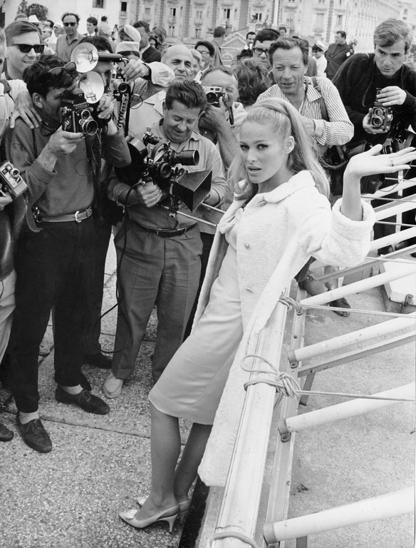 . Press photographers surround Swiss-born actress Ursula Andress on the Croisette  seafront, Cannes, on May 21, 1965, after her arrival to attend the International Film Festival. (AP Photo/Levy)