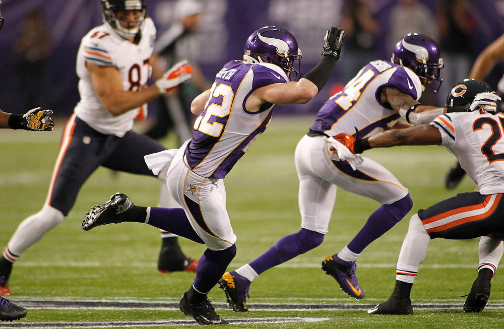 . Minnesota Vikings safety Harrison Smith (22) runs with the ball after intercepting a pass during the second half of an NFL football game against the Chicago Bears Sunday, Dec. 9, 2012, in Minneapolis. Smith returned the interception 56-yards for a touchdown. (AP Photo/Andy King)