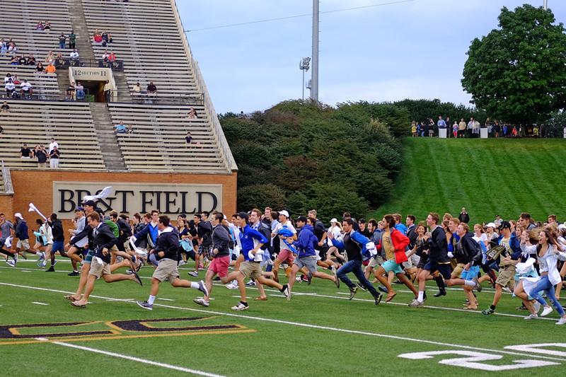 Freshmen rush the field.jpg