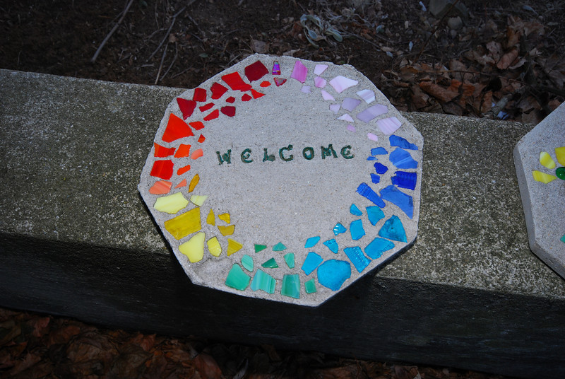 A home-made welcome sign in rainbow colors.