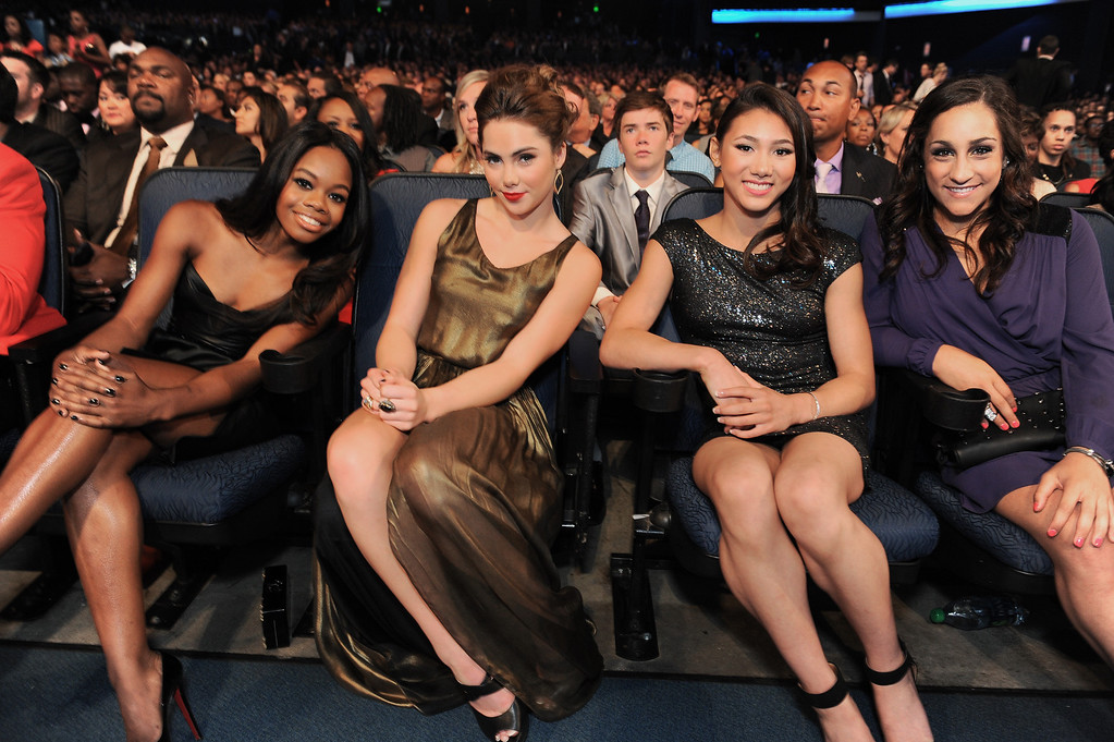 . From left, gymnasts Gabby Douglas, McKayla Maroney, Kyla Ross and Jordyn Wieber pose in the audience at the ESPY Awards on Wednesday, July 17, 2013, at Nokia Theater in Los Angeles. (Photo by Jordan Strauss/Invision/AP)