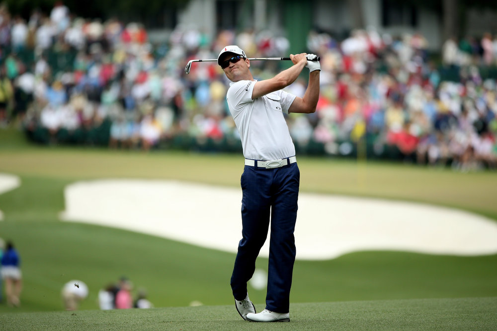 Description of . Zach Johnson of the United States hits his second shot on the first hole during the final round of the 2013 Masters Tournament at Augusta National Golf Club on April 14, 2013 in Augusta, Georgia.  (Photo by Andrew Redington/Getty Images)