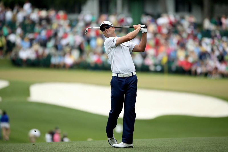 . Zach Johnson of the United States hits his second shot on the first hole during the final round of the 2013 Masters Tournament at Augusta National Golf Club on April 14, 2013 in Augusta, Georgia.  (Photo by Andrew Redington/Getty Images)
