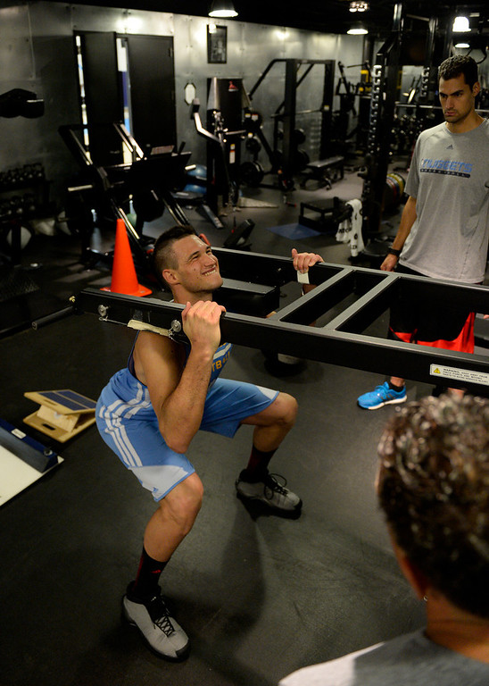 . Denver Nuggets Danilo Gallinari grimaces as he goes through a rigorous workout with assistant coach/strength and conditioning Steve Hess May 27, 2014 at Pepsi Center. (Photo by John Leyba/The Denver Post)