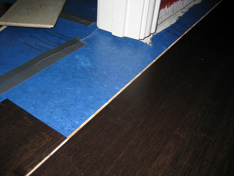 Putting flooring into closet entrance.