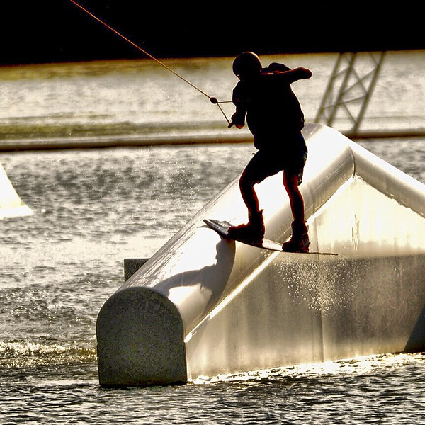 Wake board riders showing off some skills as the sun prepares to set at Roseland Wake Park