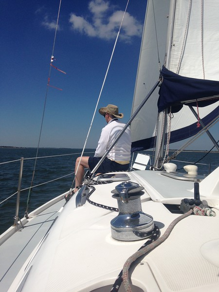 a man with a hat on a sailing boat