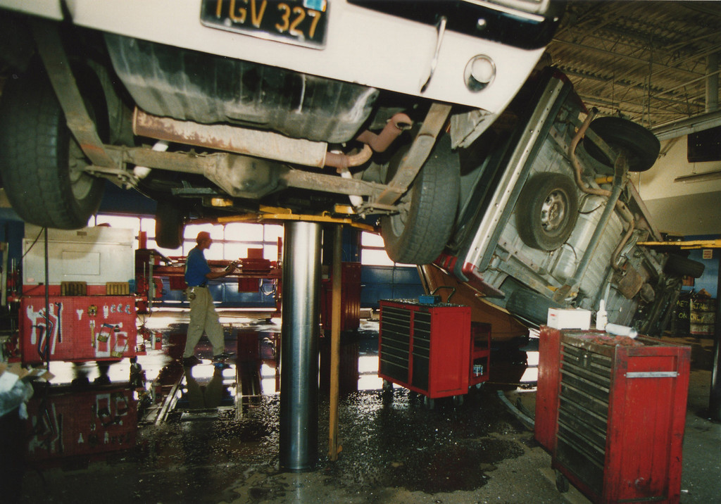 . A car fell off of a hydraulic lift in a repair shop in Northridge, CA. 1/17/1994, photo by (John McCoy/Los Angeles Daily News)
