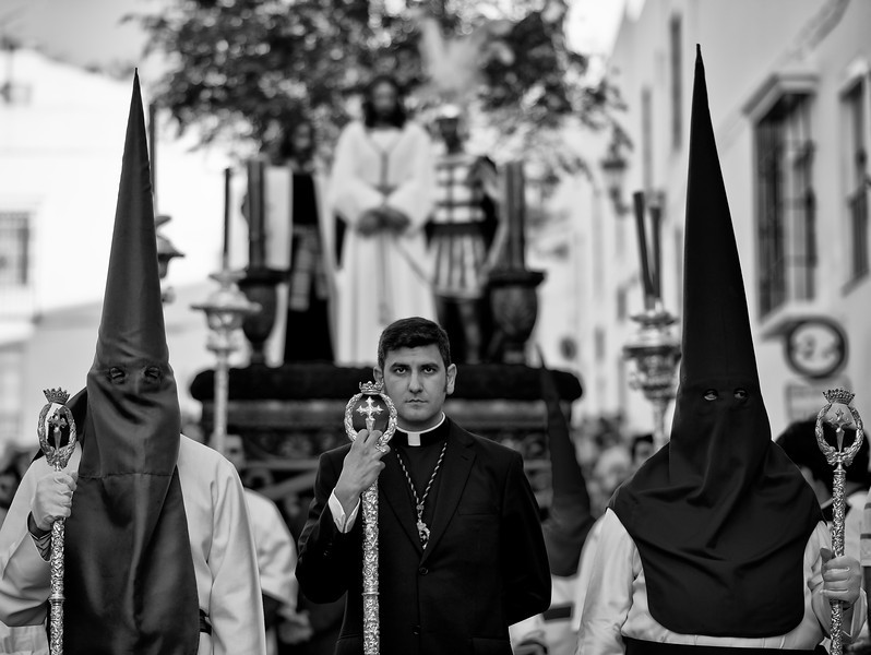 """A common feature in Spain's holy week is that every brotherhood carries magnificent """"Pasos"""" or floats with sculptures that depict different scenes from the gospels related to the Passion of Christ or the Sorrows of Virgin Mary. Many of these floats are art pieces created by Spanish artists such as Gregorio Fernandez, Juan de Mesa, Martínez Montañés or Mariano Benlliure. Brotherhoods have owned and preserved these """"pasos"""" for centuries.  Arcos de la Frontera, Andalucia, Spain, 2014"""