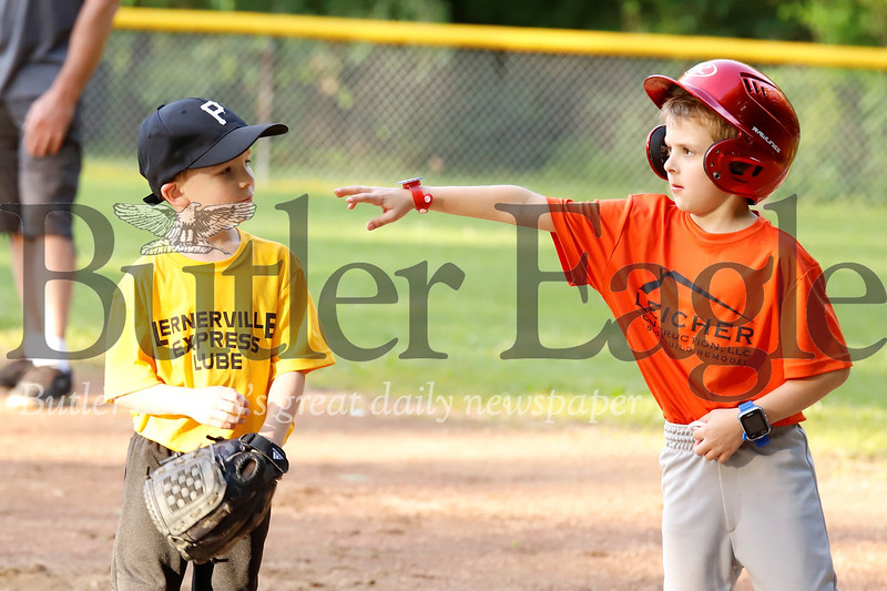We're not sure what's going on betwen friends Andy Leicher (right) and Owen Weleski at first base in the Saxonburg 4-6 year old little league game between the Pirates and Orioles, Friday, June 14. Seb Foltz/Butler Eagle