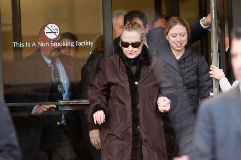 Description of . U.S. Secretary of State Hillary Clinton leaves New York Presbyterian Hospital with daughter, Chelsea (R), in New York, January 2, 2013. The secretary of state, who has not been seen in public since Dec. 7, was revealed on Sunday evening to be in a New York hospital under treatment for a blood clot that stemmed from a concussion she suffered in mid-December. REUTERS/Joshua Lott